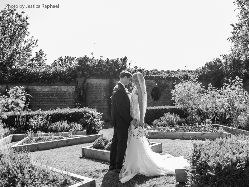Bride and groom outside in the garden