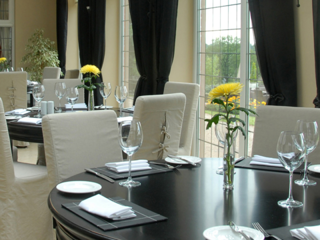 Tables laid for dinner at Nuthurst Grange
