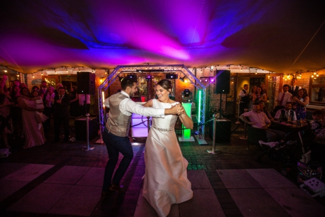 Nuthurst Grange -Wedding couples dance outside the Stables
