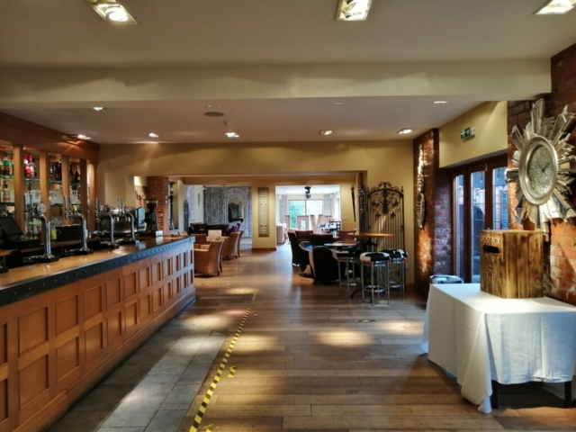 Entrance and bar area of the Stables building at Nuthurst Grange