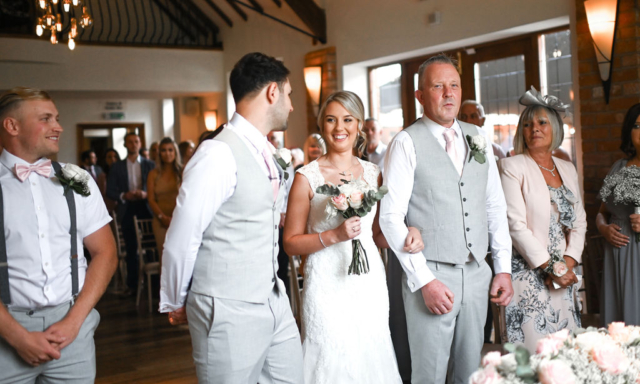 Happy bride with her parents at Nuthurst Grange Hotel